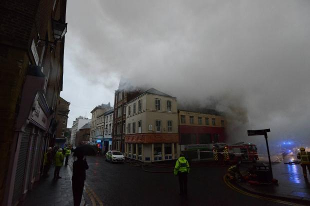 Firefighters search burning Newcastle shop amid fears people are trapped inside